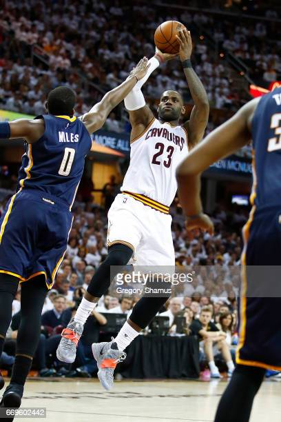 LeBron James of the Cleveland Cavaliers shoots over CJ Miles of the Indiana Pacers during the second half in Game Two of the Eastern Conference...