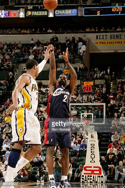 LeBron James of the Cleveland Cavaliers shoots over Danny Granger of the Indiana Pacers at Conseco Fieldhouse on February 10 2009 in Indianapolis...