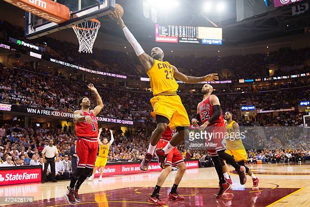 LeBron James of the Cleveland Cavaliers shoots over Derrick Rose and Taj Gibson of the Chicago Bulls in the first half during Game Two in the Eastern...