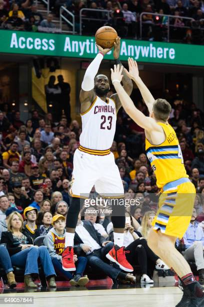 LeBron James of the Cleveland Cavaliers shoots over Juancho Hernangomez of the Denver Nuggets during the second half at Quicken Loans Arena on...