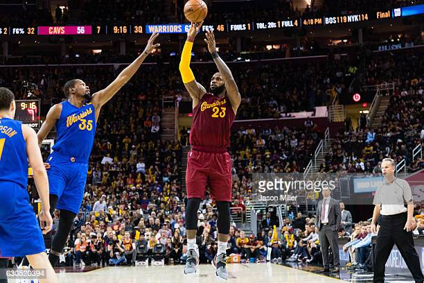 LeBron James of the Cleveland Cavaliers shoots over Kevin Durant of the Golden State Warriors during the second half at Quicken Loans Arena on...
