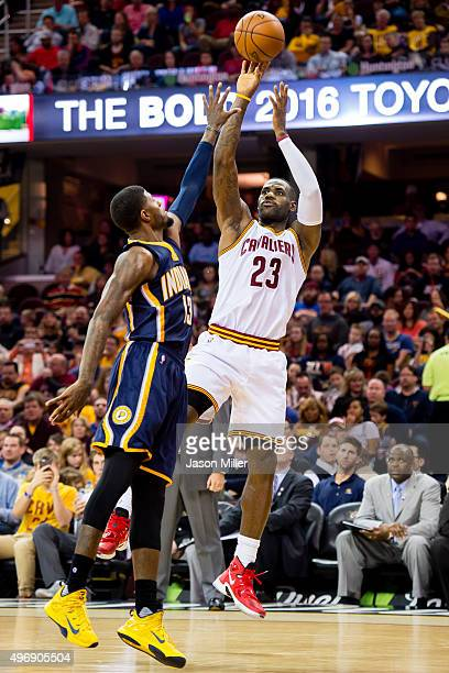 LeBron James of the Cleveland Cavaliers shoots over Paul George of the Indiana Pacers during the first half at Quicken Loans Arena on November 8 2015...
