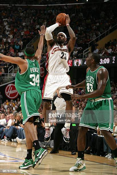LeBron James of the Cleveland Cavaliers shoots over Paul Pierce and Kendrick Perkins of the Boston Celtics in Game One of the Eastern Conference...