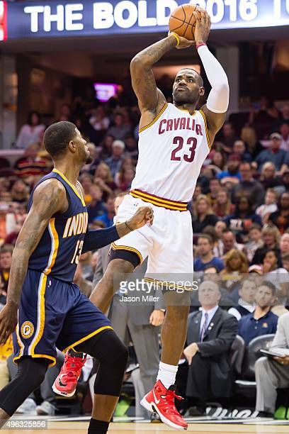 LeBron James of the Cleveland Cavaliers shoots over Tristan Thompson of the Cleveland Cavaliers during the first half at Quicken Loans Arena on...