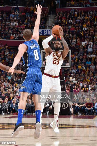 LeBron James of the Cleveland Cavaliers shoots the ball against the Orlando Magic on October 21 2017 at Quicken Loans Arena in Cleveland Ohio NOTE TO...