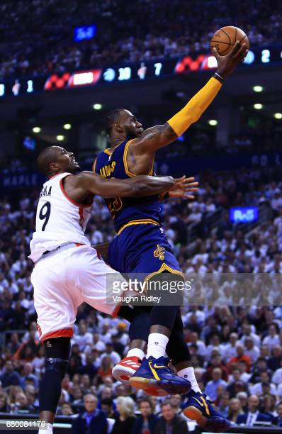 Lebron James of the Cleveland Cavaliers shoots the ball as Serge Ibaka of the Toronto Raptors defends in the first half of Game Four of the Eastern...