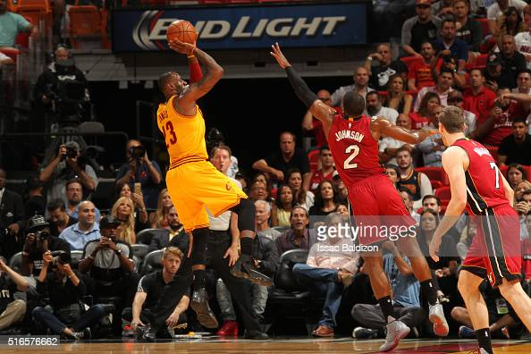 LeBron James of the Cleveland Cavaliers shoots the ball during the game against the Cleveland Cavaliers on March 19 2016 at AmericanAirlines Arena in...