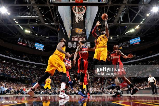 LeBron James of the Cleveland Cavaliers shoots the ball during the game against the Washington Wizards on March 25 2017 at Quicken Loans Arena in...