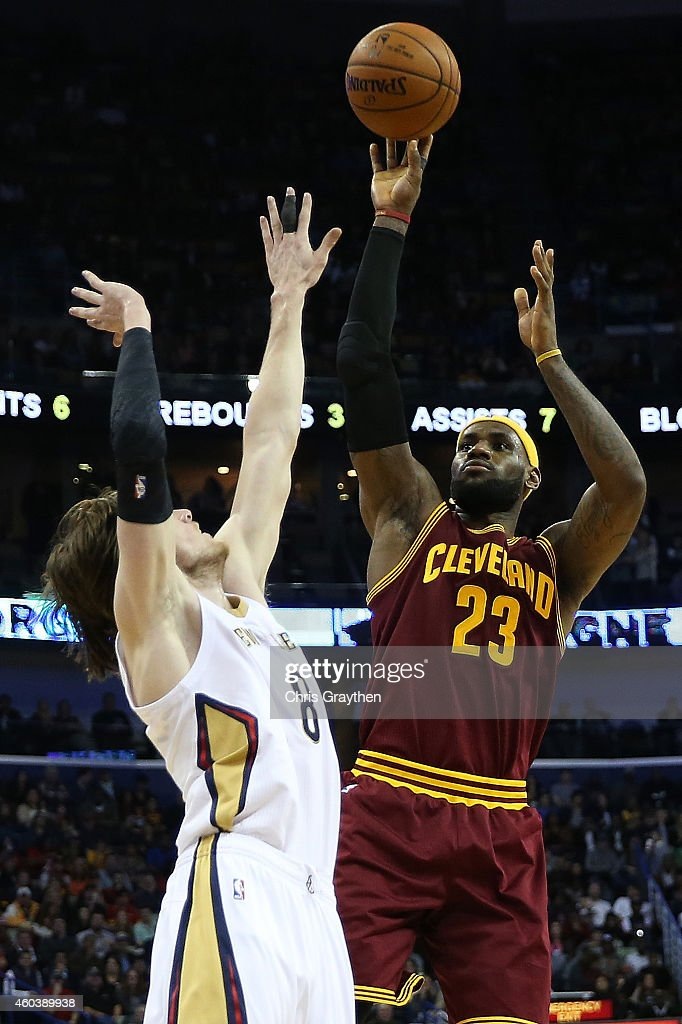 LeBron James of the Cleveland Cavaliers shoots the ball over Luke Babbitt of the New Orleans Pelicans at Smoothie King Center on December 12 2014 in...