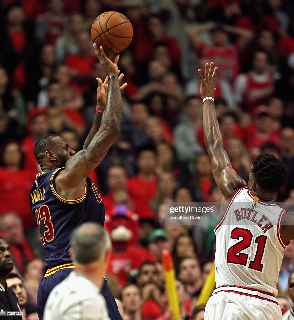 LeBron James of the Cleveland Cavaliers shoots the gamewinning two point shot over Jimmy Butler of the Chicago Bulls in Game Four of the Eastern...