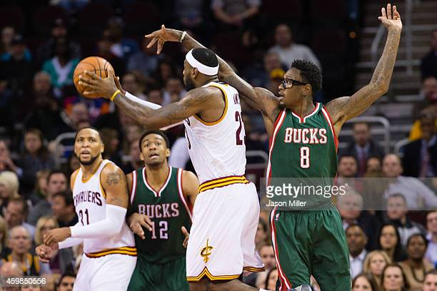 LeBron James of the Cleveland Cavaliers shoots while under pressure from Larry Sanders of the Milwaukee Bucks during the first half at Quicken Loans...