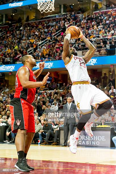LeBron James of the Cleveland Cavaliers shoots while under pressure from Chuck Hayes of the Toronto Raptors during the second half at Quicken Loans...