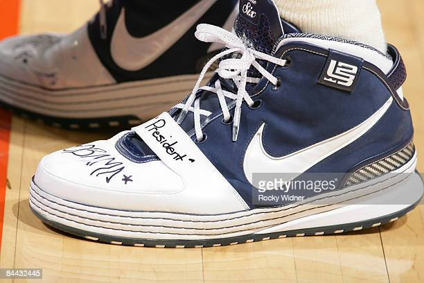 LeBron James of the Cleveland Cavaliers shows support for President Barack Obama on his shoes in the game against the Golden State Warriors on...