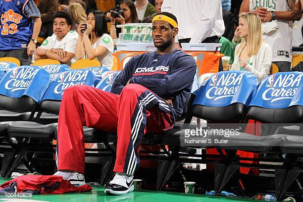 LeBron James of the Cleveland Cavaliers sits on the bench against the Boston Celtics in Game Four of the Eastern Conference Semifinals during the...