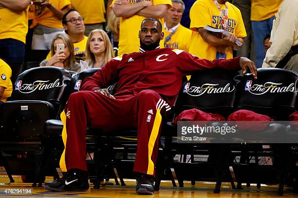 LeBron James of the Cleveland Cavaliers sits on the bench prior to Game Two of the 2015 NBA Finals against the Golden State Warriors at ORACLE Arena...