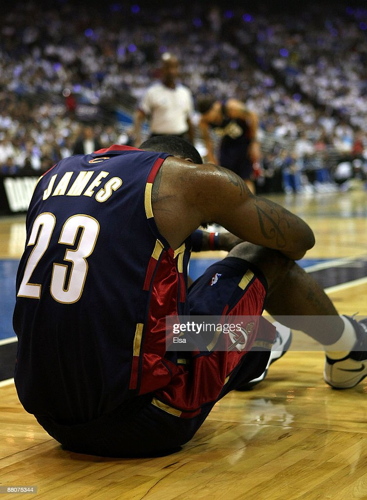 LeBron James of the Cleveland Cavaliers sits on the court after being fouled by the Orlando Magic in Game Six of the Eastern Conference Finals during...