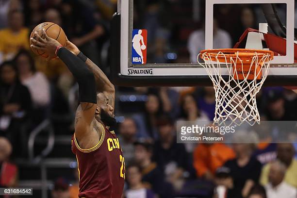 LeBron James of the Cleveland Cavaliers slam dunks during the NBA game against the Phoenix Suns at Talking Stick Resort Arena on January 8 2017 in...