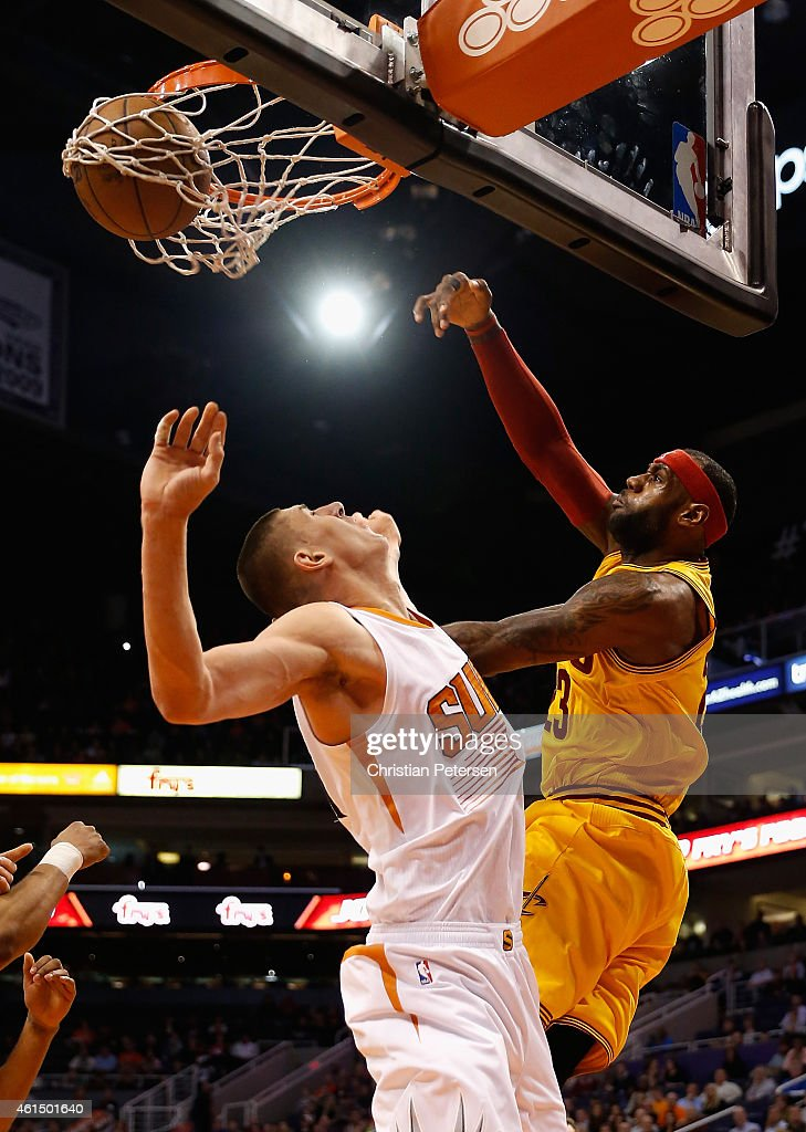 <a gi-track='captionPersonalityLinkClicked' href=/galleries/search?phrase=LeBron+James&family=editorial&specificpeople=201474 ng-click='$event.stopPropagation()'>LeBron James</a> #23 of the Cleveland Cavaliers slam dunks the ball over <a gi-track='captionPersonalityLinkClicked' href=/galleries/search?phrase=Alex+Len&family=editorial&specificpeople=8529173 ng-click='$event.stopPropagation()'>Alex Len</a> #21 of the Phoenix Suns during the first half of the NBA game at US Airways Center on January 13, 2015 in Phoenix, Arizona.