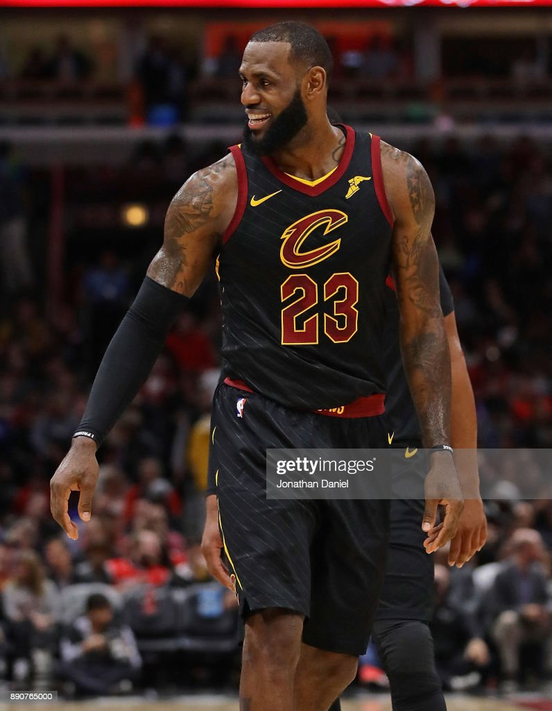 LeBron James #23 of the Cleveland Cavaliers smiles at the bench against the Chicago Bulls at the United Center on December 4, 2017 in Chicago, Illinois. The Cavaliers defeated the Bulls 113-91.