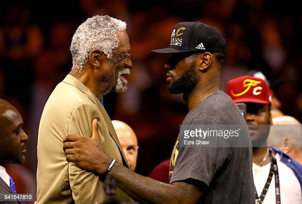 LeBron James of the Cleveland Cavaliers speaks with Bill Russell after being named the NBA Finals Most Valuable Player after defeating the Golden...