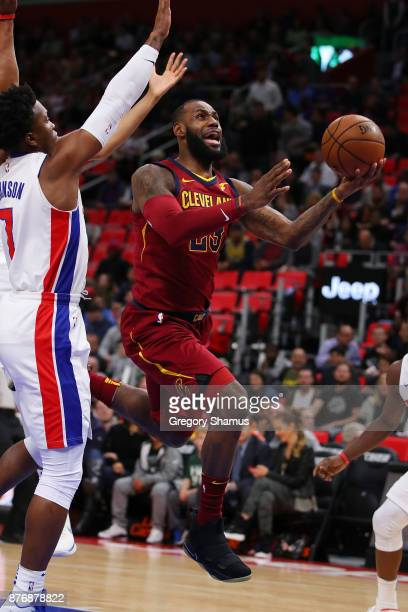LeBron James of the Cleveland Cavaliers splits the defense of Stanley Johnson and Tobias Harris of the Detroit Pistons during the first half at...