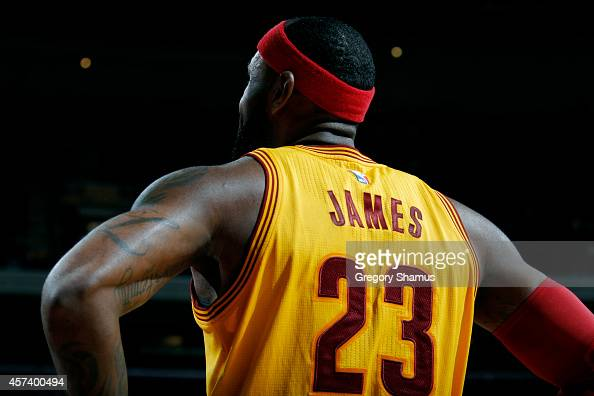 LeBron James of the Cleveland Cavaliers stands on the court during a game against the Dallas Mavericks at The Quicken Loans Arena on October 17 2014...