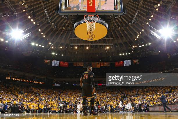 LeBron James of the Cleveland Cavaliers stands on the court in Game Five of the 2017 NBA Finals against the Golden State Warriors on June 12 2017 at...