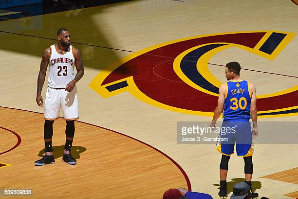 LeBron James of the Cleveland Cavaliers stands on the court with Stephen Curry of the Golden State Warriors in Game Four of the 2016 NBA Finals on...