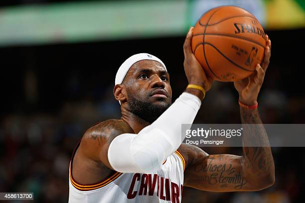 LeBron James of the Cleveland Cavaliers takes a free throw against the Denver Nuggets at Pepsi Center on November 7 2014 in Denver Colorado The...
