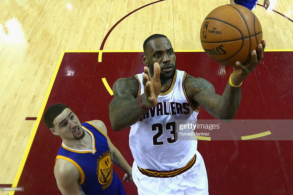 LeBron James of the Cleveland Cavaliers takes a shot in front of Klay Thompson of the Golden State Warriors in the fourth quarter in Game 4 of the...