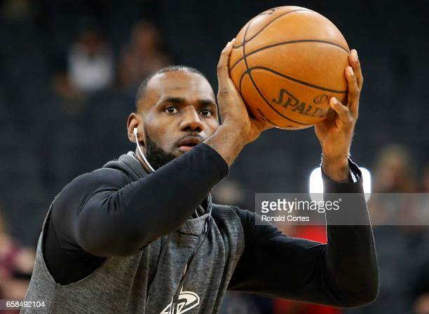 LeBron James of the Cleveland Cavaliers takes practice shots before the start of their game against the San Antonio Spurs at ATT Center on March 27...