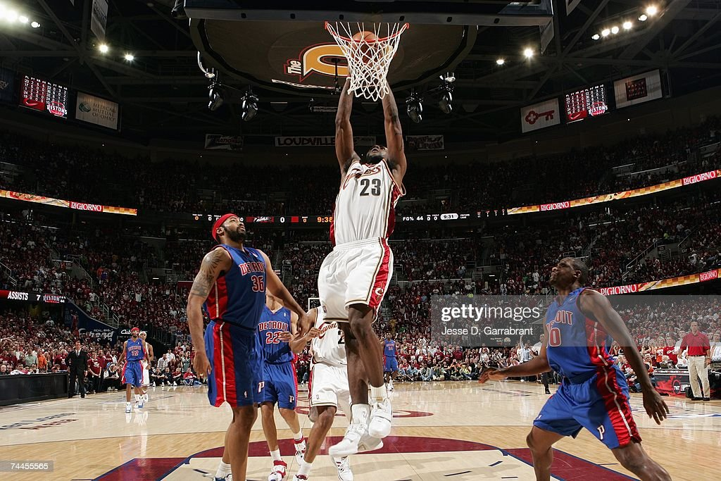 LeBron James of the Cleveland Cavaliers takes the ball to the basket against Rasheed Wallace and Lindsey Hunter of the Detroit Pistons in Game Six of...