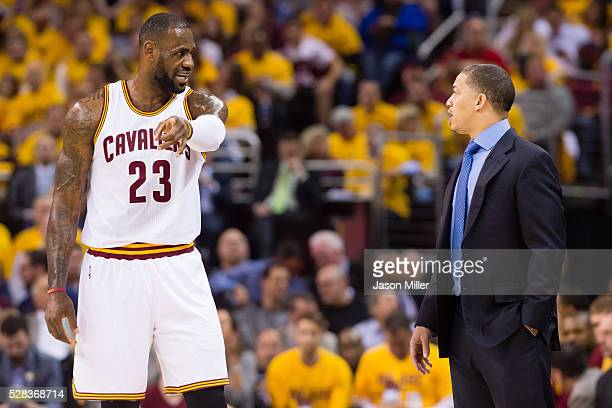 LeBron James of the Cleveland Cavaliers talks with head coach Tyronn Lue of the Cleveland Cavaliers during the first half of the NBA Eastern...