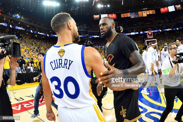 LeBron James of the Cleveland Cavaliers talks with Stephen Curry of the Golden State Warriors in Game Five of the 2017 NBA Finals on June 12 2017 at...