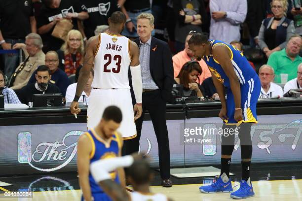 LeBron James of the Cleveland Cavaliers talks with Steve Kerr of the Golden State Warriors in Game Four of the 2017 NBA Finals on June 9 2017 at...