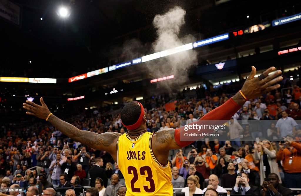 LeBron James of the Cleveland Cavaliers throws powder into the air before the start of the NBA game against the Phoenix Suns at US Airways Center on...