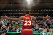 LeBron James of the Cleveland Cavaliers tosses powder into the air before taking on the Boston Celtics in Game Three of the Eastern Conference...