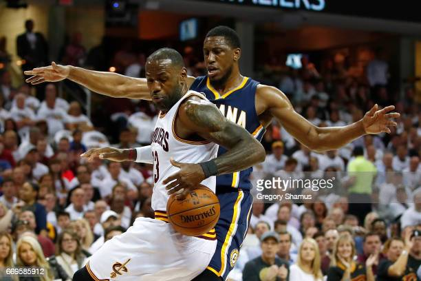 LeBron James of the Cleveland Cavaliers tries to control the ball in front of Thaddeus Young of the Indiana Pacers during the first half in Game Two...