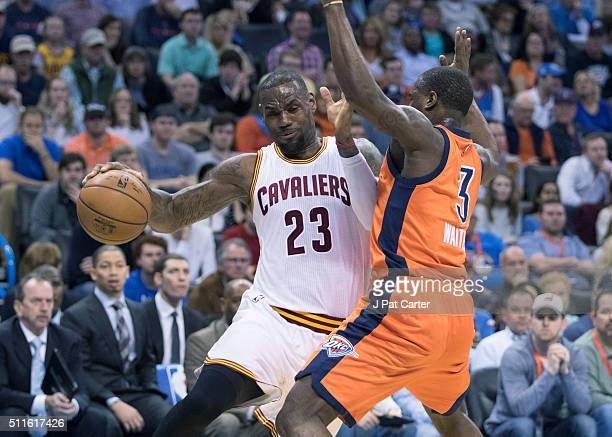 LeBron James of the Cleveland Cavaliers tries to drive around Dion Waiters of the Oklahoma City Thunder during the first quarter of a NBA game at the...