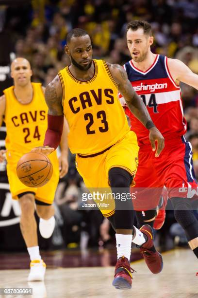 LeBron James of the Cleveland Cavaliers tries to keep an eye on Jason Smith of the Washington Wizards as he drives down court during the second half...