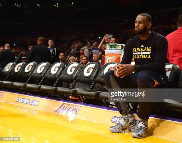LeBron James of the Cleveland Cavaliers waits for the start of the game against the Los Angeles Lakers at Staples Center on March 19 2017 in Los...