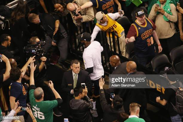 LeBron James of the Cleveland Cavaliers walks off the court after defeating the Boston Celtics 135102 in Game Five of the 2017 NBA Eastern Conference...