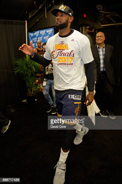 LeBron James of the Cleveland Cavaliers walks off the court after winning Game Five of the Eastern Conference Finals against the Boston Celtics...