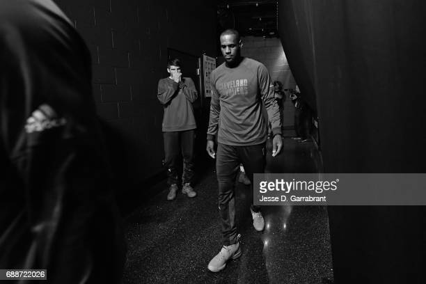 LeBron James of the Cleveland Cavaliers walks to the court before Game Five of the Eastern Conference Finals against the Boston Celtics during the...