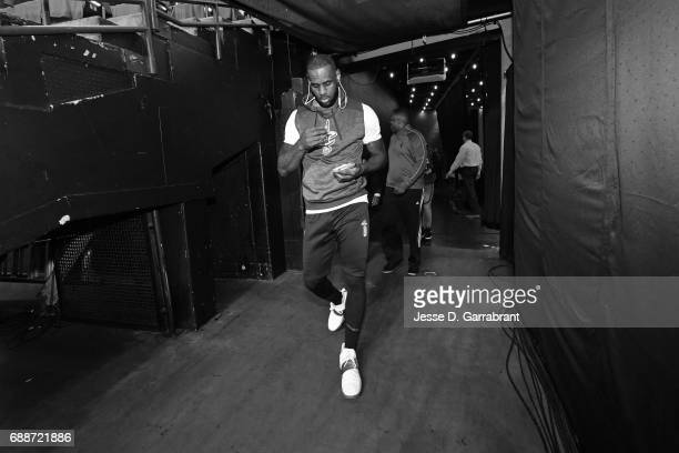 LeBron James of the Cleveland Cavaliers walks to the court to warm up before Game Five of the Eastern Conference Finals against the Boston Celtics...