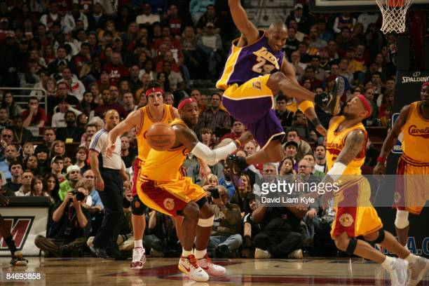 LeBron James of the Cleveland Cavaliers watches as Mo Williams takes a shoe to the face by Kobe Bryant of the Los Angeles Lakers after a steal in the...