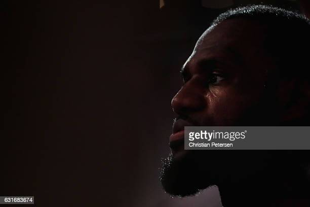 LeBron James of the Cleveland Cavaliers watches from the bench during the NBA game against the Phoenix Suns at Talking Stick Resort Arena on January...