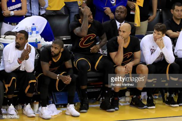 LeBron James of the Cleveland Cavaliers watches the conclusion of the game against the Golden State Warriors from the bench during the second half of...