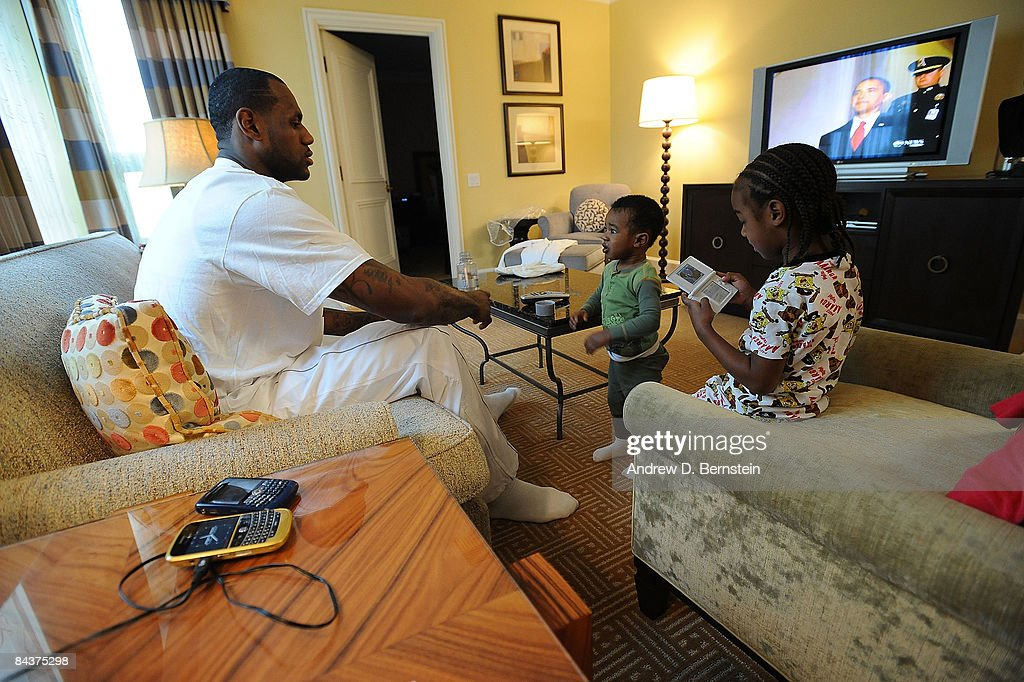 <a gi-track='captionPersonalityLinkClicked' href=/galleries/search?phrase=LeBron+James&family=editorial&specificpeople=201474 ng-click='$event.stopPropagation()'>LeBron James</a> #23 of the Cleveland Cavaliers watches with his children, Bryce and LeBron Jr., the Inauguration of the 44th President of the United States, Barack Obama, at the Beverly Wilshire Hotel on January 20, 2009 in Beverly HIlls, California.