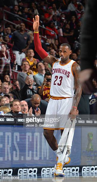 LeBron James of the Cleveland Cavaliers waves to the fans after he scored his 25000th career point against the Philadelphia 76ers at Wells Fargo...